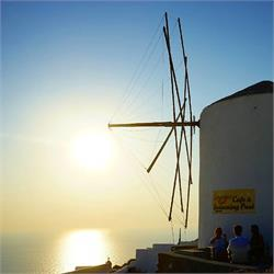 Watching the sunset in  Santorini  Greece